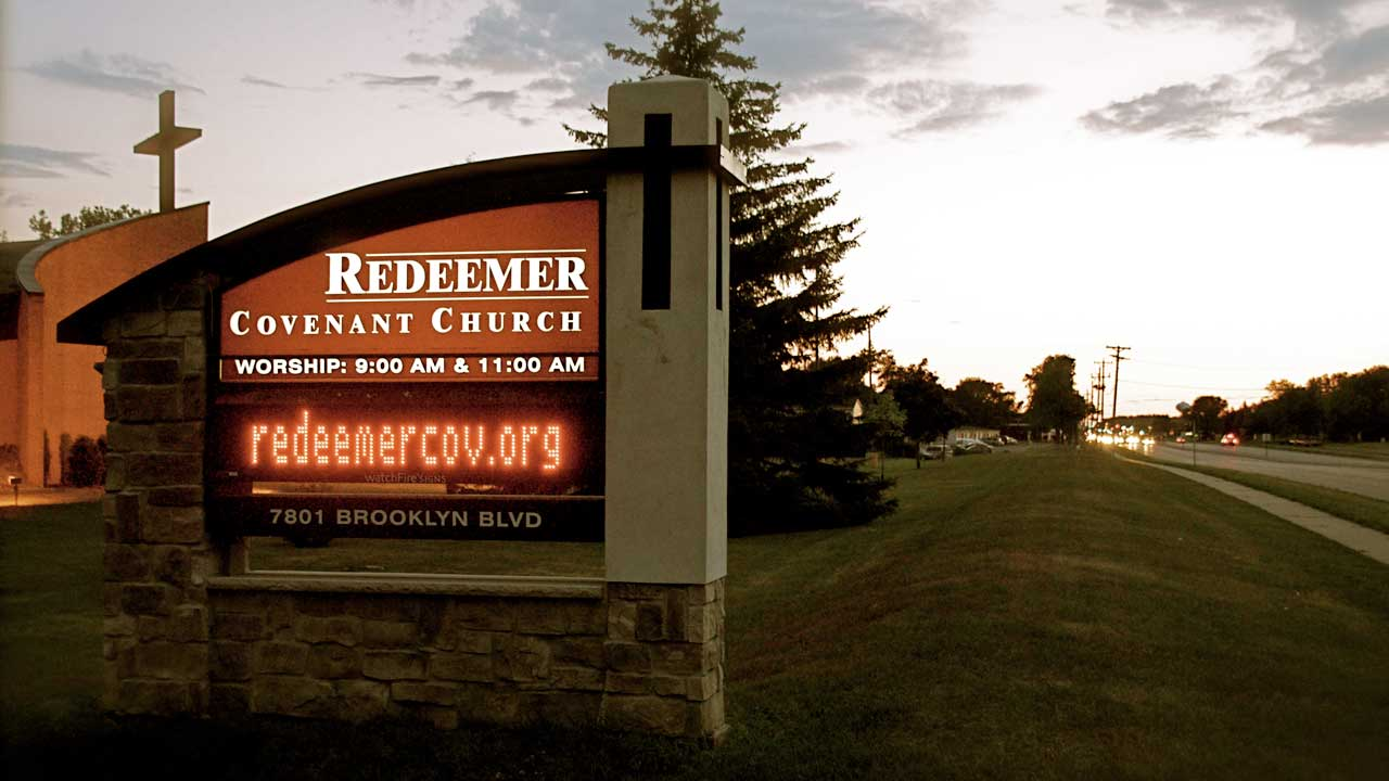 Welcome to Redeemer church sign with cross