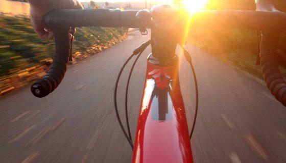 farewell biking into sunset