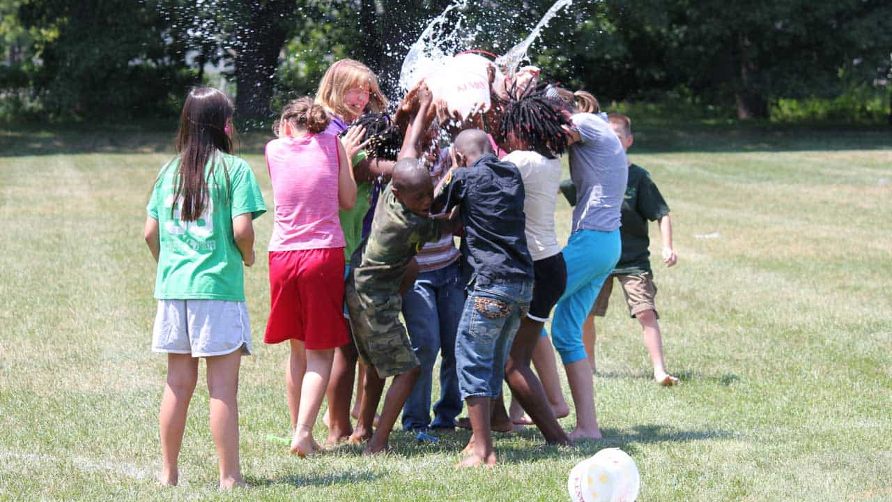 students playing with water