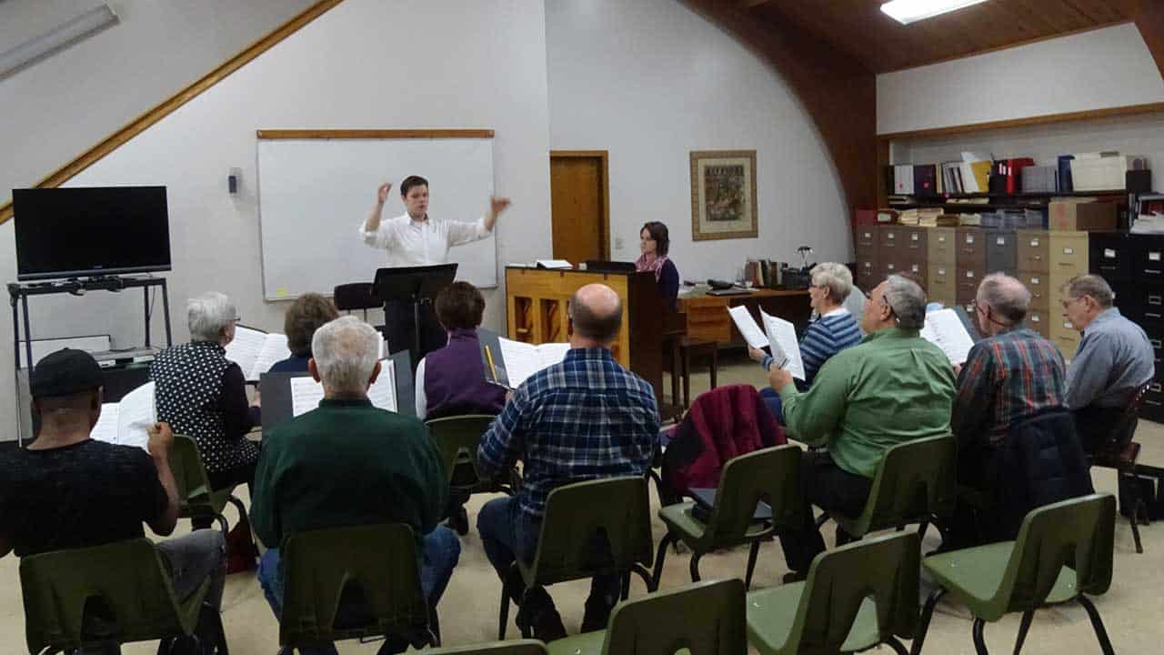 choir members and choral scholars practice