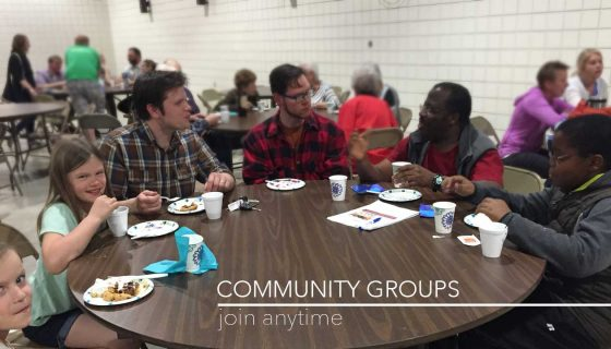 Community Groups around table talking and eating