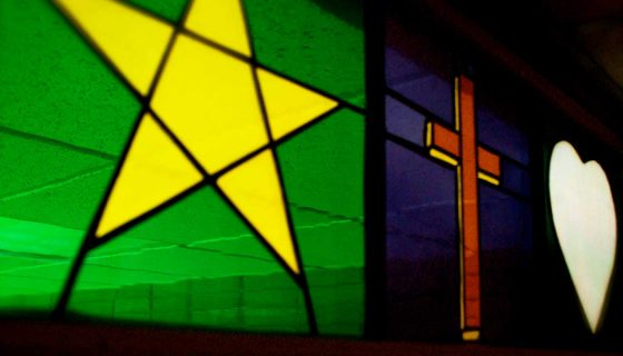Gospel of John stained glass sympolism in sanctuary